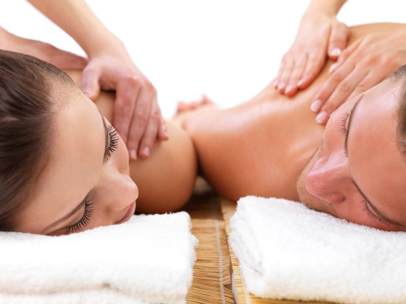 Champagne and rose petals couple massage